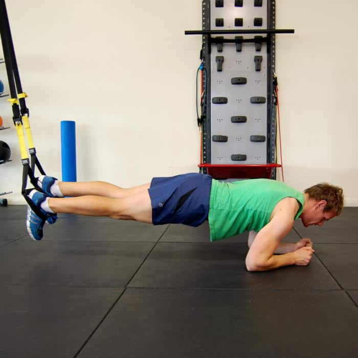 Man performing the TRX body saw