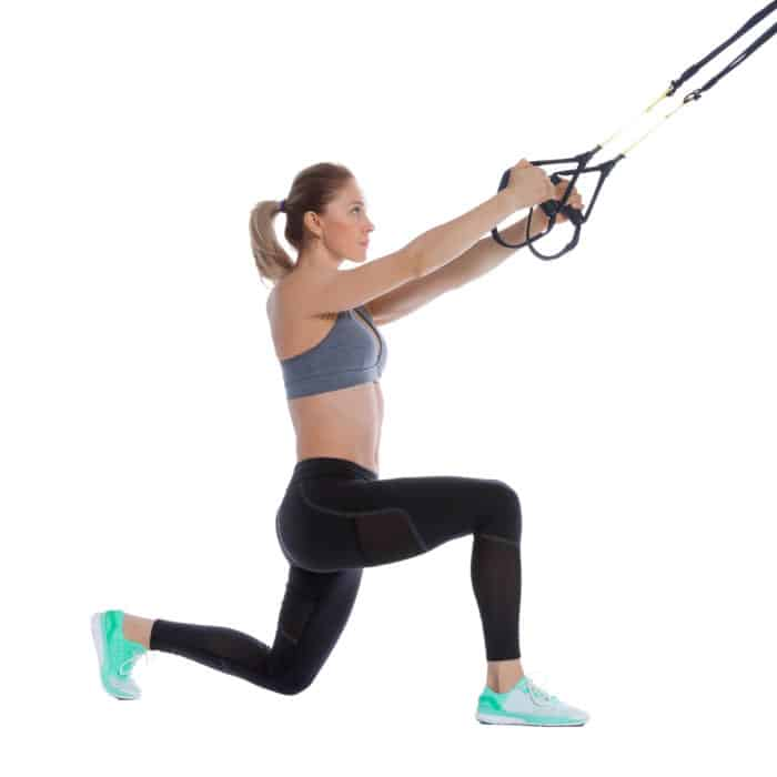 Girl performing a TRX Step Back Lunge