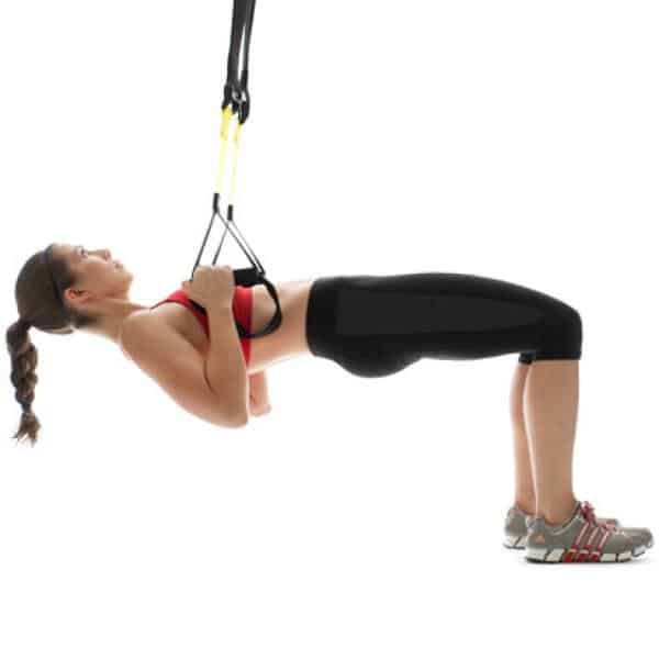 Woman performing TRX Table Rows