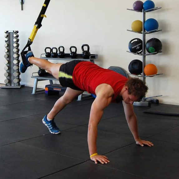 Man performing the TRX assisted push up